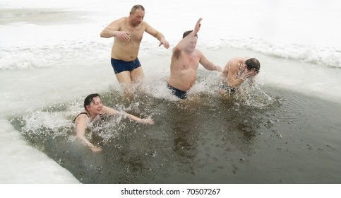 VILNIUS, LITHUANIA - FEBRUARY 5: Fans of winter swimming take a bath in some ice water on February 5, 2011 in Vilnius, Lithuania.