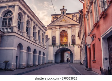 Vilnius, Lithuania: the Gate of Dawn, Lithuanian Ausros, Medininku vartai, Polish Ostra Brama, a city gate of Vilnius, one of its most important historical, cultural and religious monuments in sunrise