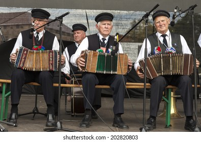 VILNIUS, LITHUANIA - JULY 04, 2014: Three old men playing accordion at traditional Lithuanian Song Celebration in Vilnius, Lithuania.
