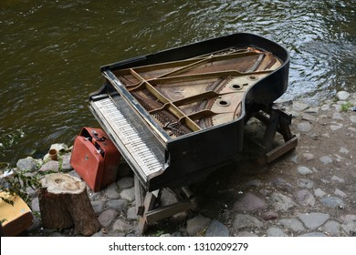 Vilnius, LIthuania - July 07 2018: Adandoned Grand Piano in a river