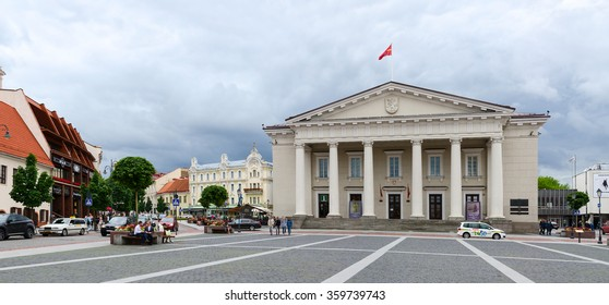 VILNIUS, LITHUANIA - JULY 10, 2015: Unidentified people walk on the Town Hall Square in Old Town, Vilnius, Lithuania