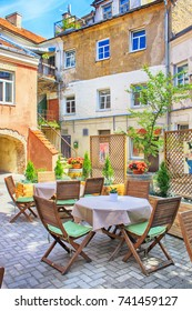 VILNIUS, LITHUANIA - JULY 18, 2015: Beautiful outdoor cafe in the patio at Old Town of Vilnius, Lithuania on beautiful summer day.