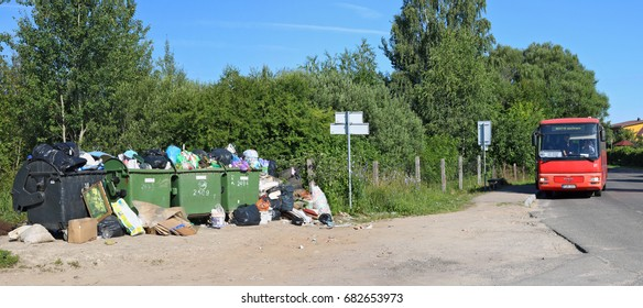 VILNIUS, LITHUANIA - JULY 23, 2017: Overcrowded garbage cans next to the bus stop. In this Baltic country very little money is allocated to the environment