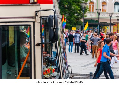 Vilnius, Lithuania - July 27, 2013: Woman driving trolleybus on foreground during the Pride parade on the background. Event celebrating lesbian, gay, bisexual, transgender, LGBTI culture and pride