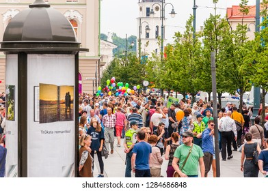 Vilnius, Lithuania - July 27, 2013: Crowd of people standing on sidewalks of Gedimino street during the Pride parade. Event celebrating lesbian, gay, bisexual, transgender, LGBTI culture and pride