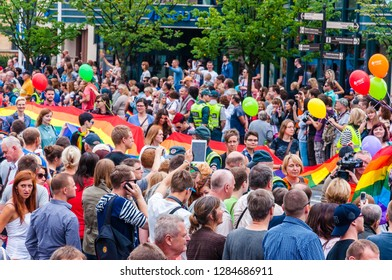 Vilnius, Lithuania - July 27, 2013: Pride parade in action. Crowd of watchers and demonstrators with rainbow flags. Event celebrating lesbian, gay, bisexual, transgender, LGBTI culture pride