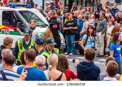 Vilnius, Lithuania - July 27, 2013: Police forces ensuring safety during the Pride parade on Gedimino street full of people. Event celebrating lesbian, gay, bisexual, transgender, LGBTI culture pride