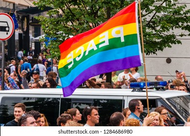 Vilnius, Lithuania - July 27, 2013: Pride parade in action. Famous rainbow peace flag above the crowd of demonstrators. Event celebrating lesbian, gay, bisexual, transgender, LGBTI culture pride