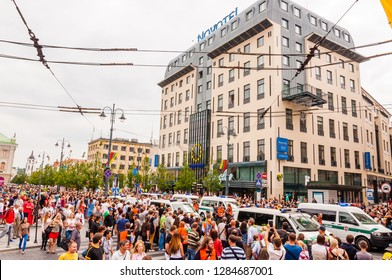 Vilnius, Lithuania - July 27, 2013: Police cars moving through street full of people during Pride parade on Gedimino street. Event celebrating lesbian, gay, bisexual, transgender, LGBTI culture pride