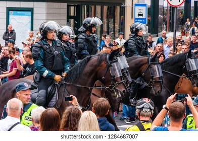 Vilnius, Lithuania - July 27, 2013: Armed mounted police forces standing at the beginning of Pride parade on Gedimino street. Event celebrating lesbian, gay, bisexual, transgender, LGBTI culture pride