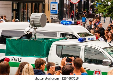 Vilnius, Lithuania - July 27, 2013: Police cars driving with big loudspeaker during the Pride parade on Gedimino street. Event celebrating lesbian, gay, bisexual, transgender, LGBTI culture pride
