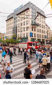 Vilnius, Lithuania - July 27, 2013: Crowd of people surrounding fire engine car driving at beginning of the Pride parade. Event celebrating lesbian, gay, bisexual, transgender, LGBTI culture and pride