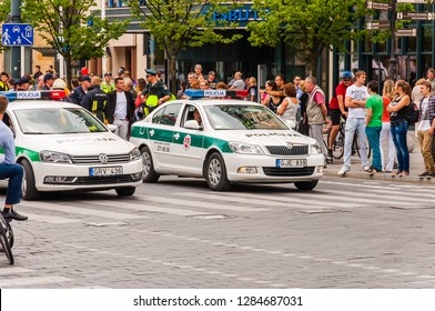 Vilnius, Lithuania - July 27, 2013: Police cars standing at the beginning of Pride parade on Gedimino street full of people. Event celebrating lesbian, gay, bisexual, transgender, LGBTI culture pride