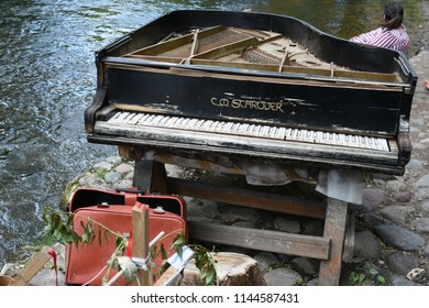 Vilnius, Lithuania - July 29 2018: Abandoned Grand Piano in a river