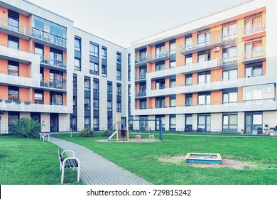 Vilnius, Lithuania - July 30, 2017: Complex of new apartment residential building with children playground as outdoor facilities.