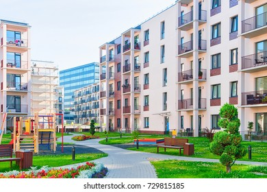 Vilnius, Lithuania - July 31, 2017: Complex of modern apartment residential building with children playground as outdoor facilities.