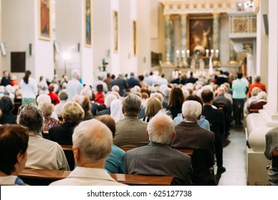 Vilnius, Lithuania - July 6, 2016: People Parishioners pray in Cathedral Basilica of Saints Stanislaus and Vladislaus during celebration Holiday in commemorate coronation in 1253 of Mindaugas King.