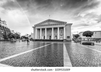 VILNIUS, LITHUANIA - JULY 9, 2017: City sunset colors in Town Hall Square. Vilnius attracts 3 million tourists annually.
