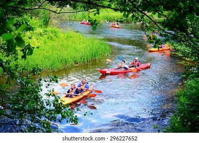 VILNIUS, LITHUANIA - JUNE 28: Canoes in River Vilnele near Entertainment and Recreation Center Belmontas on June 28, 2015, Vilnius, Lithuania.