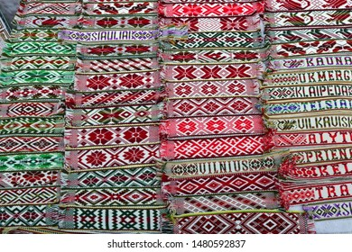 VILNIUS, LITHUANIA - MARCH 02, 2019: Linen ribbons with embroidered national patterns and names of Lithuanian cities are sold during the traditional spring fair