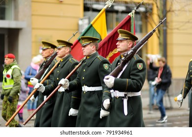VILNIUS, LITHUANIA - MARCH 11, 2017: Festive parade as Lithuania marked the 27th anniversary of its independence restoration. Parade participants carrying national flags.