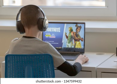 Vilnius, Lithuania - March 2, 2019: Child playing Fortnite game. Fortnite is popular online video game developed by Epic Games