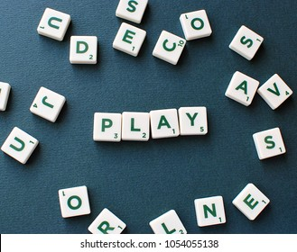 Vilnius, Lithuania, March 22, 2018: Scrabble game tiles spelling word play on green background.