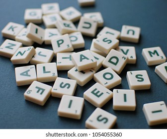 Vilnius, Lithuania, March 22, 2018: Scrabble game letters on green background.