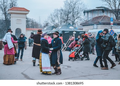 "Vilnius, Lithuania - March 3, 2019: The celebration of the big lithuanian fair ""Kaziuko Muge"". View of the square with dancing couples in national costumes."