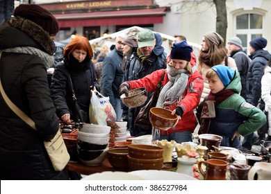 VILNIUS, LITHUANIA - MARCH 6: Unidentified people trade typical lithuanian clay pots in annual traditional crafts fair - Kaziuko fair on March 6, 2016 in Vilnius, Lithuania