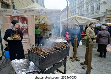 VILNIUS, LITHUANIA - MARCH 7: Unidentified people trade food in annual traditional crafts fair - Kaziuko fair on Mar 7, 2015 in Vilnius, Lithuania