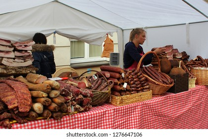 VILNIUS, LITHUANIA - MARCH 8: Unidentified people trade smoked meat in annual traditional crafts fair - Kaziuko fair on March 8, 2016 in Vilnius Lithuania
