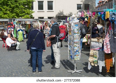 VILNIUS, LITHUANIA - MAY 09, 2015: Unidentified tourists buy souvenirs at the street market in Vilnius, Lithuania.