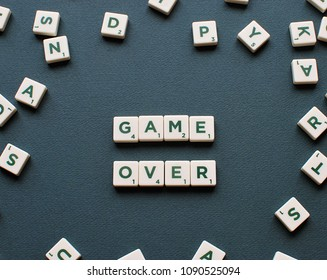 Vilnius, Lithuania, May 14, 2018: GAME OVER words made from Scrabble game letters on green background.