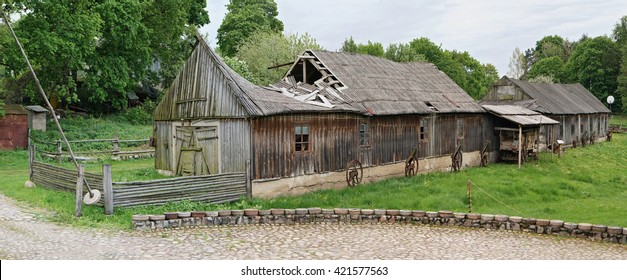 VILNIUS, LITHUANIA - MAY 15, 2016: National museum of a retro farming equipment ,tools and buildings in the territory old windmill. Pilaitie area - the most forest and green district of the Vilnius.