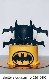 VILNIUS, LITHUANIA - MAY 15, 2019: cake for children's birthday in the form of a mask of Batman and black bats.