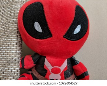 Vilnius, Lithuania - May 17, 2018: Deadpool Toy Staring. Deadpool movie premiere in Vilnius, Lithuania