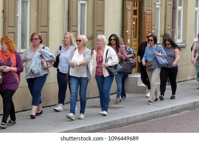 Vilnius, Lithuania - May 18, 2018: Group of women tourist walking in narrow Vilnius streets