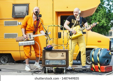 Vilnius, Lithuania - May 18, 2019: Eccentric two man rock band with handmade musical instruments performing on the street at traditional street music day in Vilnius, Lithuania