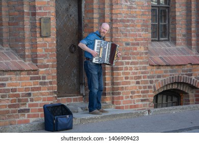 Vilnius / Lithuania  - May 19, 2019: Street musician playing piano accordion on Pilies Gatve (Castle Street).