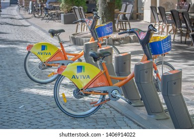 Vilnius / Lithuania  - May 19, 2019: City self-service bikes parked on Pilies Gatve (Castle Street).