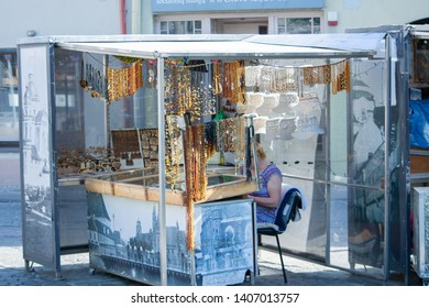 Vilnius / Lithuania  - May 19, 2019: Stall selling amber jewelry and other amber products on Pilies Gatve (Castle Street).