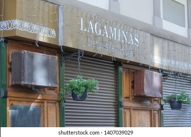 Vilnius / Lithuania  - May 19, 2019: Exterior of the Lagaminas (Suitcase) Traditional Lithuanian Restaurant, showing vintage suitcases.