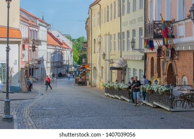Vilnius / Lithuania  - May 19, 2019: Early morning street view on Pilies Gatve (Castle Street), including exterior of the Narutis Hotel & Restaurant.