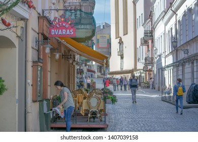 Vilnius / Lithuania  - May 19, 2019: Early morning street view on Pilies Gatve (Castle Street), including exterior of Dvaras Lithuanian restaurant.