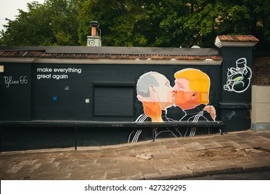 Vilnius, Lithuania - May 21, 2016: Russian President Vladimir Putin and U.S. presidential hopeful Donald Trump are kissing on the side of a barbecue restaurant in Vilnius, Lithuania