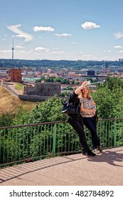 Vilnius, Lithuania - May 26, 2016: Women making selfie with Gedimino Tower on the hill and the Lower Castle down the hill in Vilnius in Lithuania. The Tower is also called as Upper Castle.