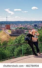 Vilnius, Lithuania - May 26, 2016: Women making selfie with Gediminas Tower on the hill and Lower Castle down the hill in Vilnius in Lithuania. The Tower is also called as Upper Castle.