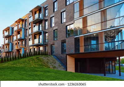 Vilnius, Lithuania - May 8, 2018: Modern residential apartment building exterior with garage. House and parking concept.