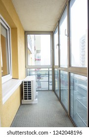 VILNIUS, LITHUANIA - NOVEMBER 06, 2018: Balcony in Modern Room with AC and Windows.